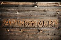 Wooden sign on side of Abiskojaure hut, Kungsleden trail, Lapland, Sweden