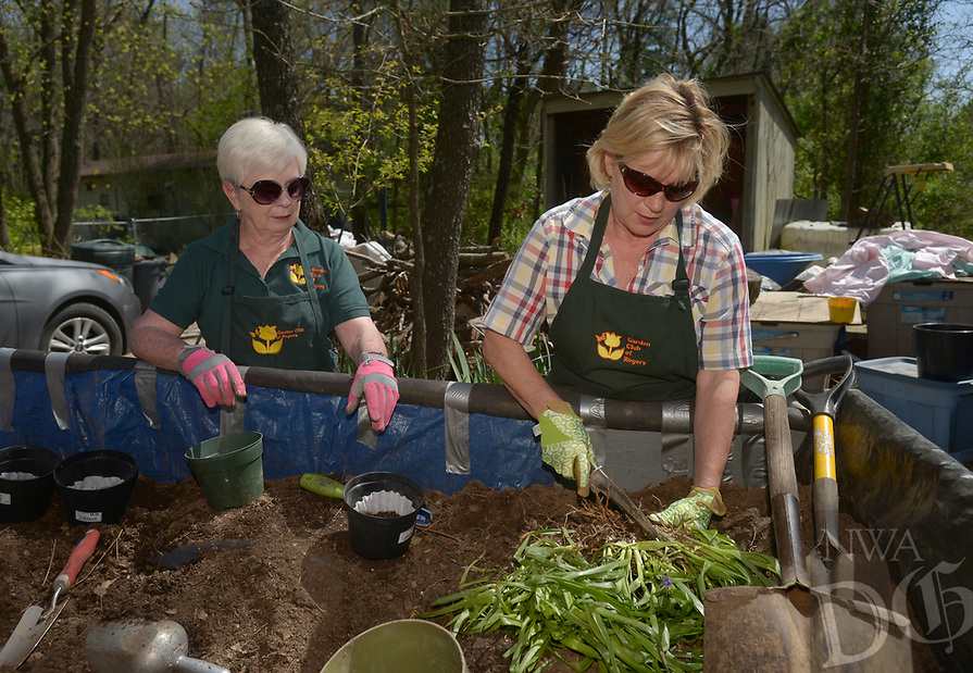 NWA Democrat-Gazette/BEN GOFF @NWABENGOFF<br /> Marcia Kroupa (left) and Cathy Patterson pott plants Saturday, April 8, 2017, as members of the Garden Club of Rogers prepare for their 42nd annual Plant &amp; Bake Sale at the home of plant sale chair Phyllis Stair in Rogers. The sale will be held at a new location this year, 1902 N. Dixieland Road in Rogers, on Saturday April 22 from 8:00am to 1:00pm.