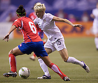Megan Rapinoe, right, of the United States tries to get past Carol Sanchez of Costa Rica during play in the CONCACAF Olympic Qualifying semifinal match at BC Place in Vancouver, B.C., Canada Friday Jan. 27, 2012. The United States won the match 3-0 to earn a berth in 2012 London Olympics.