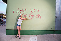 """Every day there are thousands of smiling photos, kissing photos, and goofy photos taken in front of the """"I love you so much"""" mural."""