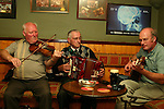 Musicians play a weekly seissun at McCarroll's/O'Connor's Bar , Ballycastle, County Antrim, Northern Ireland