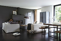 The minimal fireplace in the living/dining room which is furnished with generous seating was designed by one of the owners