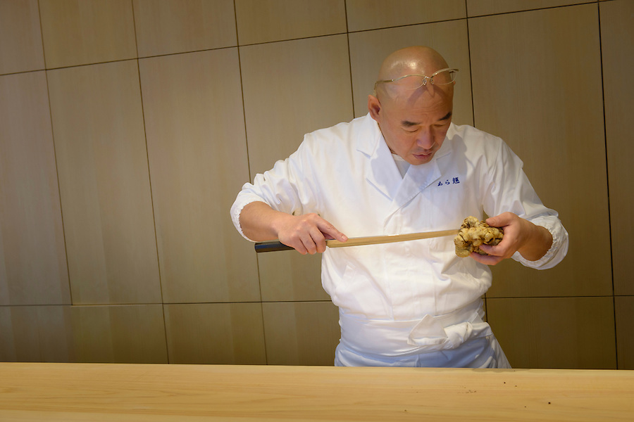 Sushi chef Mitsuhiro Araki preparing a white truffle. The Araki, London, UK, December 16, 2014. Following the success of his Three-Michelin-Star restaurant in Tokyo's Ginza, in 2014 Araki relocated to London.