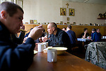 Patients share a meal at the rehabilitation program for heroin addiction operated by the NGO City Without Drugs in Yekaterinburg, Russia, on Monday, September 24, 2007. Up to 50 people at a time are crammed into a room, handcuffed to their beds, and fed a diet of only bread and water for an initial period of 27 days to ensure they take the treatment seriously and aren't tempted to quit and try again another time. This is followed by a year of community service. The program, which claims an 80% success rate for those who complete the entire course, costs 6000 rubles per month for food and housing, though the rehabilitation itself is free.