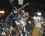 "Ole Miss guard Zach Graham (32) is defended by Murray State center Shawn Jackson (12) at the C.M. ""Tad"" Smith Coliseum in Oxford, Miss. on Wednesday, November 17, 2010."