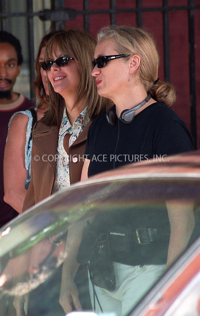 """Meg Ryan and director Jane Campion on the set of their latest film """"In the Cut."""" East Village, New York, July 24, 2002. Please byline: Alecsey Boldeskul/NY Photo Press.   ..*PAY-PER-USE*      ....NY Photo Press:  ..phone (646) 267-6913;   ..e-mail: info@nyphotopress.com"""