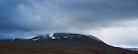 isolated mountain peak hidden in clouds, Lapland, Sweden