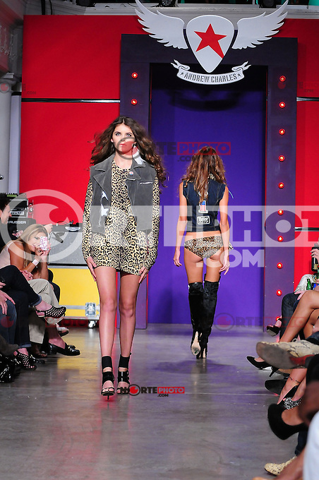 """MIAMI, FL - October 21: A model walking the runway during Andy Hilfiger introduction of rock inspired clothing line called """"Andrew Charles"""" during Funksion Fashion Week at The Moore Building on October 21, 2011 in Miami, Florida. (photo by: MPI10/MediaPunch Inc.)"""