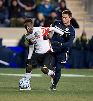 Mikias Eticha (11) of Maryland controls the ball in front of Eric Bird (11) of Virginia during the NCAA Men's College Cup semifinals at PPL Park in Chester, PA.  Maryland defeated Virginia, 2-1.
