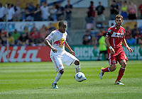 New York midfielder Dane Richards (19) plays the ball in front of Chicago defender Gonzalo Segares (13).  The Chicago Fire tied the New York Red Bulls 1-1 at Toyota Park in Bridgeview, IL on June 26, 2011.