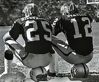 Oakland Raiders wide receiver Fred Biletnikoff and quarterback Ken Stabler on the sideline waiting for the defense to get the ball back. 1977 photo by Ron Riesterer