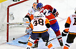 26 October 2009: New York Islanders' goaltender Martin Biron gives up a third period goal to Montreal Canadiens left wing forward Travis Moen giving the Habs a 2-1 lead at the Bell Centre in Montreal, Quebec, Canada. The Canadiens defeated the Islanders 3-2 in sudden death overtime for their 4th consecutive win. Mandatory Credit: Ed Wolfstein Photo