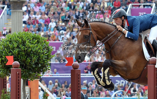 Nicolas Touzaint (FRA) riding Hildago de L'ile. Equestrian Eventing - PHOTO: Mandatory by-line: Garry Bowden/SIP/Pinnacle - Photo Agency UK Tel: +44(0)1363 881025 - Mobile:0797 1270 681 - VAT Reg No: 768 6958 48 - 31/07/2012 - 2012 Olympics - Greenwich, London, England
