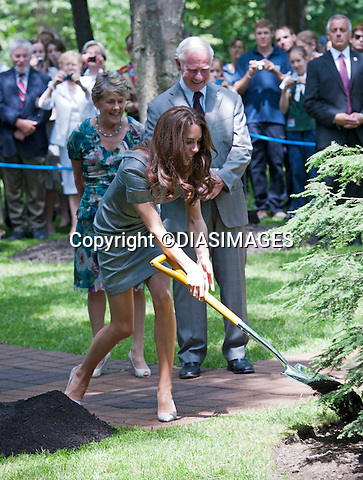 """WILLIAM & KATE TREE PLANTING.throw spades of earth on to a 2-year-old tree dedicated to their visit, inthe garden of the Governor General's residence, Rideau Hall, Ottawa_02/07/2011.Mandatory Credit Photo: ©DIASIMAGES..**ALL FEES PAYABLE TO: """"NEWSPIX INTERNATIONAL""""**..IMMEDIATE CONFIRMATION OF USAGE REQUIRED:.DiasImages, 31a Chinnery Hill, Bishop's Stortford, ENGLAND CM23 3PS.Tel:+441279 324672  ; Fax: +441279656877.Mobile:  07775681153.e-mail: info@newspixinternational.co.uk"""