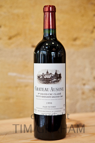 Bottle of expensive fine wine from Chateau Ausone in wine merchants shop in St Emilion in the Bordeaux wine region of France
