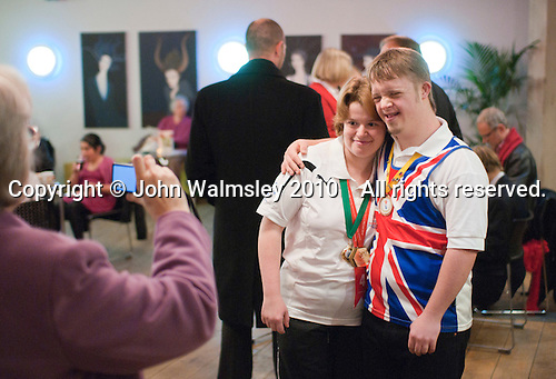 "Two athletes having their photo taken.   Special Olympics Surrey put on a show,   ""Beyond the Stars"", at the Rose Theatre, Kingston upon Thames to raise money for the  SOGB team.  The Special Olympics are for athletes with learning disabilities."