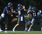 Ole Miss quarterbacks Evan Ingram (19), Zack Stoudt (8) and Barry Brunetti (11) go through a drill at  football practice in Oxford, Miss. on Sunday, August 7, 2011.