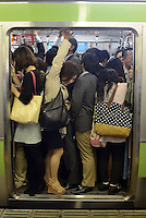 Passengers squeeze onto full trains during morning rush hour, Shinjuku, Tokyo. With up to 4 million passengers passing through it every day, Shinjuku station, Tokyo, Japan, is the busiest train station in the world. The station was used by an average of 3.64 million people per day.  That&rsquo;s 1.3 billion a year.  Or a fifth of humanity. Shinjuku has 36 platforms, and connects 12 different subway and railway lines.  Morning rush hour is pandemonium with all trains 200% full. <br /> <br /> Photo by Richard jones / sinopix