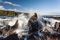 Waves crash onto lava rocks on the shore of Nua'ailua Bay at Keanae Lookout, on the way to Hana, Maui.
