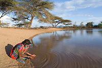 Ethiopian girl at a waterhole.