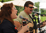 Deuces Child, Gigi Tanglewood & Lou Patrick, performing at Saugerties Farmer's Market, Saugerties, NY on Saturday, July 2, 2011. Photo © Jim Peppler 2011.