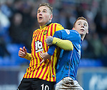 St Johnstone v Partick Thistle....17.01.15  SPFL<br /> Ryan Stevenson tussles with Liam Caddis<br /> Picture by Graeme Hart.<br /> Copyright Perthshire Picture Agency<br /> Tel: 01738 623350  Mobile: 07990 594431