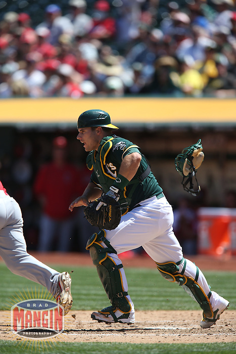 OAKLAND, CA - APRIL 30:  Josh Phegley #19 of the Oakland Athletics chases a bunt against the Los Angeles Angels during the game at O.co Coliseum on Thursday, April 30, 2015 in Oakland, California. Photo by Brad Mangin