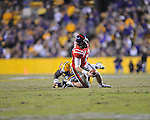 Ole Miss quarterback Bo Wallace (14) is sacked by LSU defensive tackle Anthony Johnson (90) at Tiger Stadium in Baton Rouge, La. on Saturday, November 17, 2012. LSU won 41-35.....