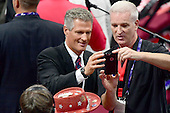 Former United States Senator Scott Brown (Republican of Massachusetts), left, poses for a photo with an unidentified man at the 2016 Republican National Convention held at the Quicken Loans Arena in Cleveland, Ohio on Wednesday, July 20, 2016.<br /> Credit: Ron Sachs / CNP<br /> (RESTRICTION: NO New York or New Jersey Newspapers or newspapers within a 75 mile radius of New York City)