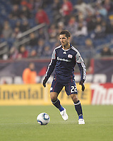New England Revolution midfielder Benny Feilhaber (22) at midfield. In a Major League Soccer (MLS) match, the New England Revolution defeated Sporting Kansas City, 3-2, at Gillette Stadium on April 23, 2011.