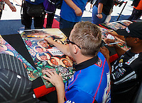 Jul 30, 2016; Sonoma, CA, USA; NHRA top fuel driver Richie Crampton signs autographs during qualifying for the Sonoma Nationals at Sonoma Raceway. Mandatory Credit: Mark J. Rebilas-USA TODAY Sports