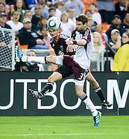 Perry Kitchen (23) of D.C. United crosses the ball past Drew Moor (3) of the Colorado Rapids during the game at RFK Stadium in Washington, DC.  D.C. United tied the Colorado Rapids, 1-1.
