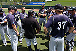 03 June 2016: Nova Southeastern assistant coach Eric Cruz (in black) talks to his players before the game. The Nova Southeastern University Sharks played the Millersville University Marauders in Game 13 of the 2016 NCAA Division II College World Series  at Coleman Field at the USA Baseball National Training Complex in Cary, North Carolina. Nova Southeastern won the first game of the best of three Championship Series 2-1.