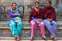 Three young women enjoying being photographed at Patan Square in Lalitpur, Nepal