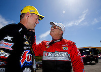 Jul. 27, 2014; Sonoma, CA, USA; Runner-up, V. Gaines (right) congratulates NHRA pro stock driver Jason Line after winning the Sonoma Nationals at Sonoma Raceway. Mandatory Credit: Mark J. Rebilas-