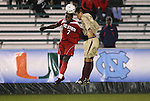 13 November 2009: NC State's Ronnie Bouemboue (7) and Boston College's Patrick Chin (right) challenge for a header. The North Carolina State University Wolfpack defeated the Boston College Eagles 1-0 at WakeMed Stadium in Cary, North Carolina in an Atlantic Coast Conference Men's Soccer Tournament Semifinal game.