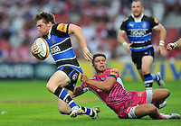 Tom Heathcote is tackled by Rob Coote. J.P. Morgan Premiership Rugby 7s match, between Bath Rugby and Exeter Chiefs on July 27, 2012 at Kingsholm Stadium in Gloucester, England. Photo by: Patrick Khachfe / Onside Images