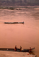 A group of Buddhist Monks early morning at the banks of the Mekong River in Luang Prabang, Laos, northern laos