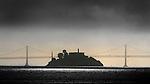 Alcatraz Island is framed between the Oakland Bay Bridge.