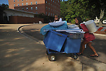 University of Mississippi freshman Kaitlyn Cochran and her mother Sherry Cochran roll items on a cart as students began moving into Stockard-Martin Dorm  in Oxford, Miss. on Friday, August 19, 2011. Classes begin on Monday, August 22, 2011.