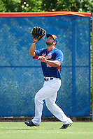 New York Mets left fielder Tim Tebow (15) catches a fly ball during an Instructional League game against the Miami Marlins on September 29, 2016 at the Port St. Lucie Training Complex in Port St. Lucie, Florida.  (Mike Janes/Four Seam Images)