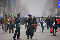 Chinese policemen on Wangfujing street of Central Beijing, China