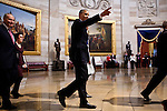 President Barack Obama walks through the US Capitol Rotunda to the inaugural luncheon, January 21, 2013 in Washington, D.C.