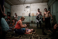 Mother assists her child injured by shelling, while hiding in a bomb shelter in Donetsk, Eastern Ukraine.