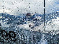 Switzerland. Canton Valais. Verbier is a village located in the municipality of Bagnes. The village lies on a south orientated terrace at around 1,500 metres. The terrace lies on the east side of the Val de Bagnes. Verbier is one of the largest holiday resort and ski areas in the Swiss Alps. Cable car. 3.01.2012 © 2012 Didier Ruef *** Local Caption *** .