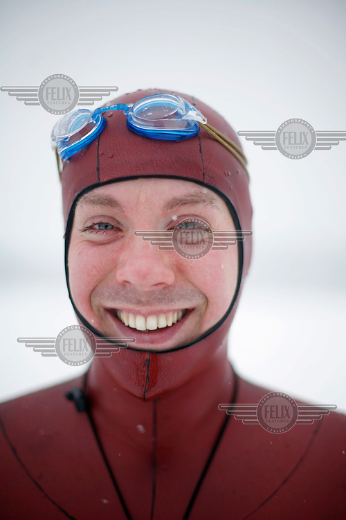 Bjarte Nygard from Norway. Freediving competition Oslo Ice Challenge at freshwater lake Lutvann outside the Norwegian capital Oslo. Atheletes, including current and former world champions, entered a hole in the ice to compete. The participants reached depths down to 52 meters below the surface.