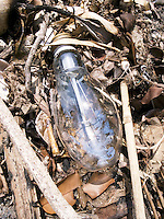 Thailand. Trat province. Ko Rang island. Broken bulb on the floor. Ko Rang island is a natural park. 13.04.09 © 2009 Didier Ruef
