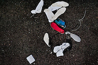 "White socks and insoles of alleged Mara gang members are seen thrown away after the initial search on the yard at the detention center in San Salvador, El Salvador, 20 February 2014. Although the country's two major gangs reached a truce in 2012, the police holding cells currently house more than 3000 inmates, five times more than the official built capacity. Partly because the ordinary Mara gang members did not break with their criminal activities (extortion, street-level distribution of drugs, etc.), partly because Salvadorean police still applies controversial anti-gang law which allows to detain almost anyone for ""suspicion of gang membership"". Accused young men are held in police detention centers where up to 25 inmates may share a cell of five-by-five metres. Here, in the dark overcrowded cages, under harsh and life-threatening conditions, suspected gang members wait long months, sometimes years, for trial or for to be transported to a regular prison."