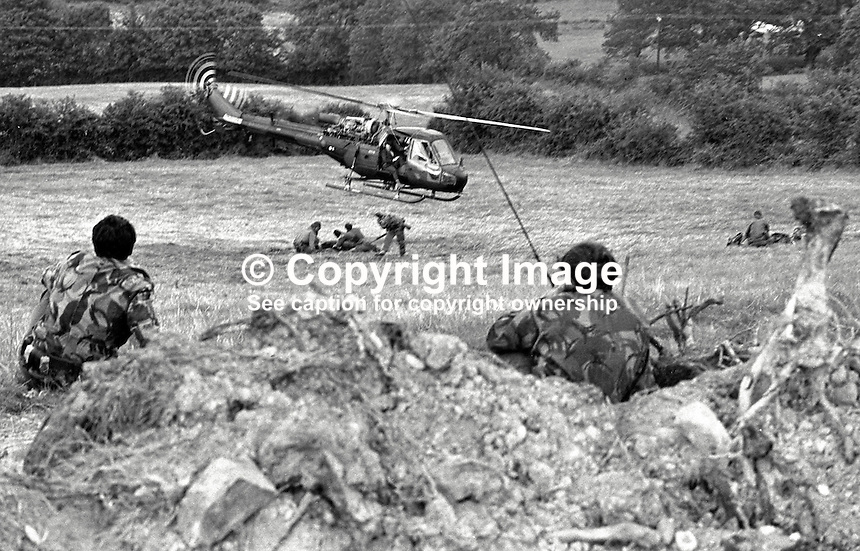 Scene of Provisional IRA explosion at British Army observation post two miles from Crossmaglen, Co Armagh, N Ireland, in which 2 soldiers died and 2 others were injured. The part-time post had been checked out for booby trap bombs but none had been detected. Two soldiers provide cover for the rescue helicopter as it flies in for the dead and injured. The soldiers who died were Marine Michael Southern and Corporal Dennis Leach. 197408130442b..Copyright Image from Victor Patterson, 54 Dorchester Park, Belfast, UK, BT9 6RJ..Tel: +44 28 9066 1296.Mob: +44 7802 353836.Voicemail +44 20 8816 7153.Skype: victorpattersonbelfast.Email: victorpatterson@me.com.Email: victorpatterson@ireland.com (back-up)..IMPORTANT: If you wish to use this image or any other of my images please go to www.victorpatterson.com and click on the Terms & Conditions. Then contact me by email or phone with the reference number(s) of the image(s) concerned.