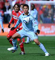 Sporting KC defender Roger Espinoza (15) receives the ball in front of Chicago Fire forward Gaston Puerari (18).  The Chicago Fire defeated Sporting KC 3-2 at Toyota Park in Bridgeview, IL on March 27, 2011.